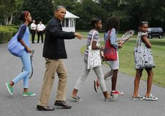 U.S. President Barack Obama (2nd L) walks his daughters, Malia (L) and Sasha ®, and two family friends, towards Marine One on the South Lawn at the White House in Washington, before departing for Camp David in Maryland, August 24, 2012. (via Photo...