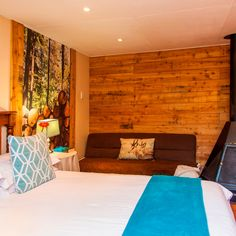 Room 1 has a double bed, en-suite bathroom with shower and cosy fireplace. Cosy Fireplace, Double Beds, Awards, Couch, Shower, Bathroom, Furniture, Home Decor, Full Beds