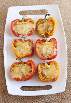I love southwestern flavors! I also love how southwestern/mexican food lends itself to vegetarian friendly meals, since beans are often the protein (instead of beef or chicken). I also love how pretty the peppers are, such a colorful meal. Oh and this meal takes around 30 minutes to make. Cheesy, spicy, healthy and easy-gotta love that! Quinoa Stuffed Peppers, serves four to five. 1 cup quinoa 5-6 tablespoons olive oil...
