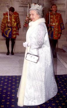1994 from Queen Elizabeth II's Royal Style Through the Years Her Royal Highness arrived to the state opening of Parliament wearing a fur-trimmed white coat, metallic handbag and crown. Queen Liz, Die Queen, Hm The Queen, Her Majesty The Queen, Save The Queen, Princess Elizabeth, Princess Margaret, Queen Elizabeth Ii, Princess Diana