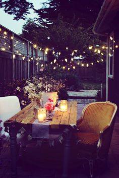 Fairy lights, outdoor, wooden table.