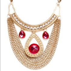 Statement Necklace STATEMENT NECKLACE?  Yes this one is!  It's an antique gold tone metal with a mixture of link chain and mash chain, enhanced CZ's and fuchsia colored stones!  Has a lobster clasp closure.  Comes with it's own velvet pouch!  NWT Jewelry Necklaces