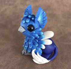Icy Blue Gryphon by Dragonsandbeasties