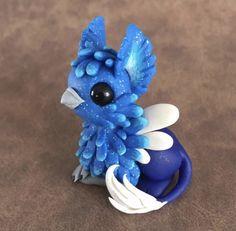 Icy Blue Gryphon by Dragonsandbeasties