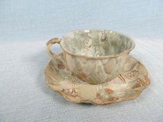 Foto temprana 20thc japonesa Banko Ware taza de té y platillo Tapiz