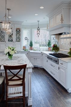 Gorgeous Traditional Kitchen by Drury Design Kitchen & Bath Studio, via drurydesigns.com. Chandeliers, gorgeous backsplash, marble island...
