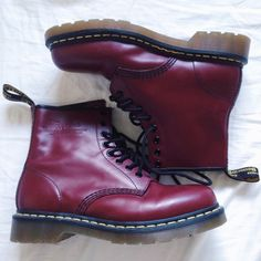 "NWOT Dr. Martens Cherry 1460 W Boot New never worn dr.marten cherry/oxblood boots Smooth leather fashions a classic lace-up ankle boot with a comfortable round toe and heavy-duty outsole. 1 1/4"" heel; 5/8"" platform (size 9). 6 1/2"" boot shaft. Leather upper/leather and textile lining/synthetic sole. By Dr. Martens; imported. BP. Shoes. Dr. Martens Shoes Ankle Boots & Booties"