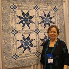 """My next project is what to do with my feathered star block (approx 38"""" square).  I like these corners, or I could use matching LeMoyne stars, but the striped sashing I'm waffling on."""