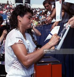 Gabriela Sabatini of Argentina signing autographs after winning the ladies singles final of the US Open Tennis Championships held in Flushing Meadows, New York, USA during September 1990. She beat Steffi Graf 6-2, 7-6. (Photo by Bob Thomas/Getty Images).