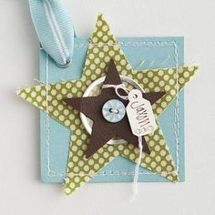 Wintry Star Gift Tag  Design by Robyn Werlich  Tie a personalized tag to a die-cut star for this pretty gift tag. Layer stars and a metal-rim tag on paper to give the tag dimension. Then stitch around the outside for a homespun look.