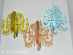 DIY Cardboard Chandelier -- you can buy them on Etsy but I'd prefer making one.  I'd really hang it in the house!