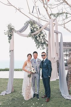 Rachel Lim, entrepreneur and co-founder of homegrown fashion label Love, Bonito tied the knot with her fiancé Leonard at Alila Villas Uluwatu in an affair planned by The Wedding Concepteur that we can only describe as Wearing not one but tw Wedding Arch Tulle, Wedding Ceremony Arch, Wedding Ceremony Decorations, Ceremony Backdrop, Wedding Gowns, Grey Wedding Theme, Grey Suit Wedding, Floral Wedding, Wedding Flowers