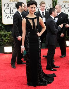 HIT: Morena Baccarin shows just enough skin with a sheer high neckline and beaded side panels.