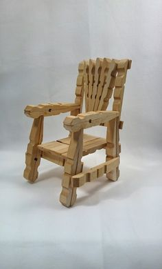 Handmade Wooden Chair for Barbie or Miniature Doll House. Approximately 6.5 tall made entirely from clothes pins and glue. This piece was sealed