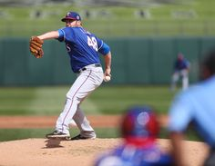 Colby Lewis deals a strike in the Rangers' 6-2 victory over the Royals!