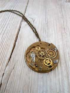Vintage pocket watch main plate and parts brass necklace   Ive used this unique vintage brass pocket watch main plate, enhanced with a variety of sizes of vintage brass gears, to create this intoxicating unisex Steampunk pendant . A timeless array of vintage watch pieces all suspended on brass textured oval cable chain.   A unique Steampunk pendant, sure to dazzle!   All findings are made with metal components which have then been richly antiqued through a professional plating process…