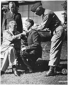 President Roosevelt, General Marshall, Brigadier General William H. Wilbur, and General Patton. Wilbur was receiving the  Medal of Honor.