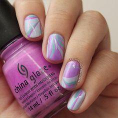 polish-and-prejudice-nails:  Blue-Aqua-Purple Water Marble \ feat. China Glaze and Essie