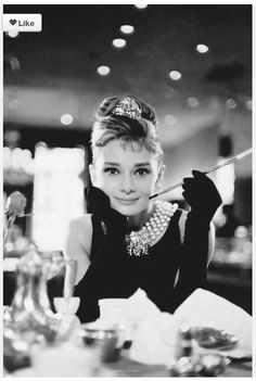 My cousin NEEDS to have this style wedding - just a white version of the dress and a fur muff - Wedding Breakfast at Tiffany's