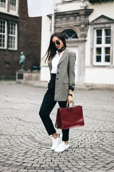 Try accessorising a smart blazer and slacks outfit with a sophisticated neck tie like Beatrice Gutu to get that edgy, individual feel. Blazer: Cerruti 1881, Shirt: Asos, Trousers: Zara, Sneakers: Stan Smith, Bag: Zara, Watch: Daniel Wellington.