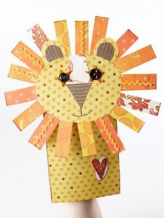 Friendly Lion Puppet - Create animal puppets from paper for an inexpensive kids' craft. Use buttons and other embellishments to add life to the animals. Button eyes and a full mane of paper strips give this lion paper-bag puppet his cheerful charm.