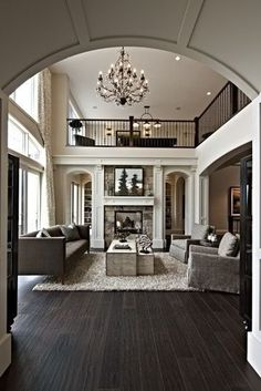 Warm livingroom, love the wood floor with a cream area rug:)