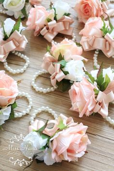 Made to order items The price is for one boutonnieres / corsage. Processing time: 5 working days. Silk Flower Roses in pink with white color flowers Size: Roses about 7cm The pictures are showing 03 blush ribbon color for bow and imitation pearl for wristlet. Type and details of products: For boutonniere – it will come with a pin at the back. For ribbon wrist corsage – tie ribbon will be in 38inches. For pearl wrist corsage – pearl cuff stretched bracelet in 7 inches, other size please…