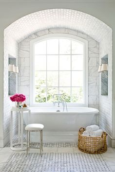 free standing tub with a beautiful window, all in white