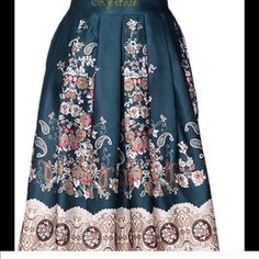 Vintage pattern midi skirt Vintage pattern print full midi skit. Elastic waistband will for a size 24-30 in waist. Length is 26 inches. 100% polyester. Shop Nicety Skirts Midi
