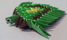 We will need: 55 green, 22 brown, 4 yellow triangular pieces (modules) This turtle origami is a simple and rather funny figure. Make the same turtle or. 3d Origami, Easy Origami Flower, Origami Frog, Origami And Quilling, Origami Folding, Useful Origami, Origami Flowers, Quilling Art, Turtles