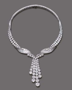AN IMPORTANT DIAMOND NECKLACE, BY STERLE   Designed as an entwined baguette and brilliant-cut diamond ribbon suspending a detachable graduated brilliant-cut diamond four-row tassle pendant, circa 1960, 38.0 cm. long, with French assay marks for platinum and gold  Signed Sterlé Paris, no. 8685