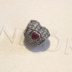 PANDORA IN MY HEART BEAD AUTHENTIC PANDORA. New never used. 925 silver with red and clear cubic zirconia. NO TRADING!! Firm price. Bundle discount offered on purchases of $100.00 or more. Thanks for visiting my closet ♥️ Pandora Jewelry Bracelets