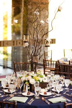 Branch centerpiece with candles and low flowers in wooden box