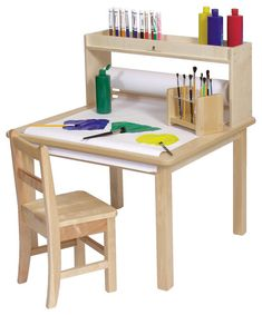 Arts and Crafts table but with all the features. Unit comes with a x long paper roll that can be pulled over the table surface. Two inch deep storage area above paper roll holder.