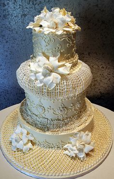Wedding cake decorated in an extreme Victorian style. Influenced by Lambeth's string work, this cake is for those who want to capture the detail of a bygone era . This design , originally by early Rosebud decorator Mary Squires, is given a fresh look by Cory.