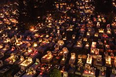 Credit: Peter Komka/EPA Salgótarján, Hungary: Candles burn on graves to mark All Saints Day in a cemetery