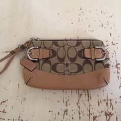 Authentic Coach Wristlet Gorgeous authentic Coach Wristlet, perfect condition. Does not fit my iPhone 6 Plus, which is what I bought it for. Will most likely fit the 6/6s, I believe. See photos. Coach Bags Clutches & Wristlets