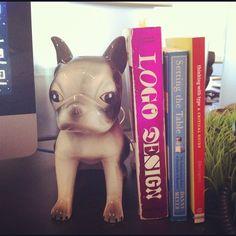 Focus: Desk Flair. Senior Designer John Howells' desk pup matches his real pup.