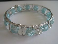 Wire wrapped silver bangle bracelet with light by LeeliaDesigns, $12.00