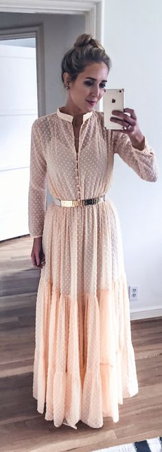pale coral peach long sleeve maxi dress with subtle dots and nude gold waist belt