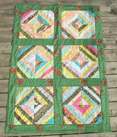 scrappy strip quilt by minouette, via Flickr