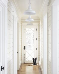 white plank hallway: What an awesome door!