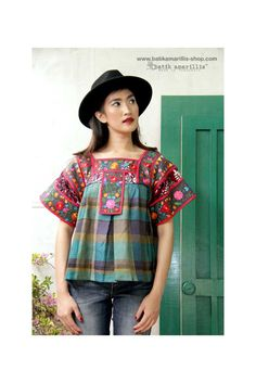 Available at Batik Amarillis webstore www.batikamarillis-shop.com                               Batik Amarillis's Frida  embroidery blouse with the twist! This magnificent  Mexican traditional blouse inspired  blouse is  super pretty & comfy with its bold & beautiful embroidery