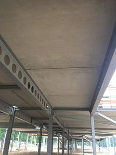 """Precast pre-stressed solid floor slabs or Super wideslab are manufactured using an innovative casting system ensuring a truly smooth soffit finish. Solid wideslab is often referred to as """"plate flooring"""" Flood Precast - Flood Group Floor Slab, Thermal Mass, Steel Bed, School S, Stress, It Is Finished, Construction, Flooring, Outdoor Decor"""