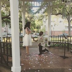 This is the most romantic proposal, and he even included their families for an added surprise!