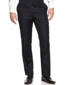 Tommy Hilfiger Navy Tonal Stripe Trim-Fit Pants (640188400140) A timeless American standard. These good-looking navy pants from Tommy Hilfiger offer an updated trim fit.