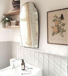 Vintage mirror over pedestal sink