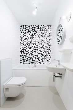 Minimalist bathroom with black and white Ceramica Bardelli tiles.