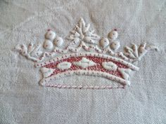 The crown of a marquis on a set of damask napkins. Sold by chatelaine-chic