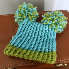 love this style loom-knit hat.  gotta find a pattern